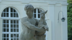 Boy with goat kid statue in Lazienki Park, Warsaw Stock Footage