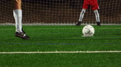 A soccer player making a penalty kick past the goalkeeper Stock Footage