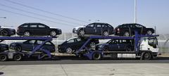 Transportation of new cars by truck Kuvituskuvat