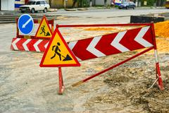 detour signs next to the road repair - stock photo