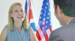 4K Male & female diplomats in negotiation shake hands on a dea - stock footage