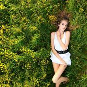 Young girl lying on meadow Stock Photos