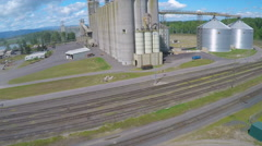 A rising aerial shot over a cement plant or grain refinery. Stock Footage