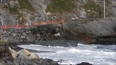 Van negotiates narrow track, Palliser Bay, New Zealand. Stock Footage