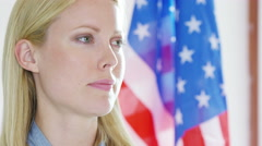 4K Portrait of international businesswoman or politician with American flag - stock footage