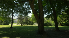 Lying on grass near New Orangery in Lazienki Park, Warsaw Stock Footage