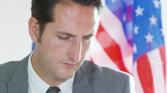 4K Portrait of international businessman or politician with American flag Stock Footage