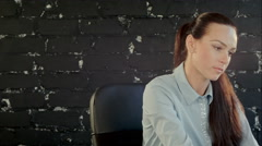 Cheerful business woman conversing on mobile phone - stock footage