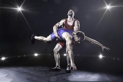 Freestyle wrestler throwing Kuvituskuvat