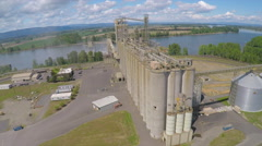 An aerial shot over a cement plant or grain refinery. Stock Footage