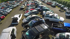 An aerial shot over an automobile junkyard. Stock Footage