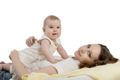 Beautiful young mother and her smiling baby - stock photo