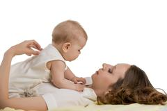Childcare. Photo of mother plays with her baby - stock photo