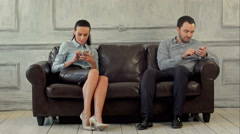 Young couple and ignoring each other looking at smartphones Stock Footage