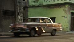 Old Havana street with classic cars and motorcycle Stock Footage