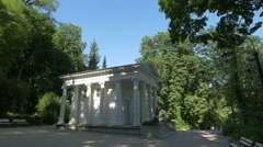 Father with his daughter visiting the Temple of Diana in Lazienki Park, Warsaw Stock Footage