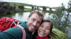 Selfie - travel couple on lake Myvatn Iceland - Friends taking selfies fun Stock Footage