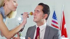 4K Make up artist prepares political figure for a tv broadcast - stock footage