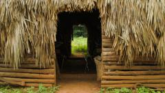 Door opening view of a traditional rural farmer hut in Vinales valley Cuba Stock Footage