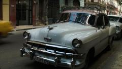 Stock Video Footage of Classic white chevrolet on a street in old Havana