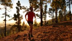 Stock Video Footage of Running man trail runner in cross-country run - Male athlete