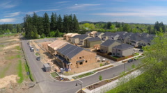 An aerial image over houses under construction in a subdivision. - stock footage