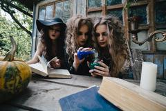 Stock Photo of Three vintage witches perform magic ritual