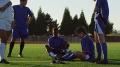 Soccer players enjoying some downtime on the field Stock Footage