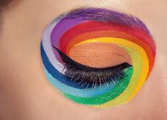 Closed eye with colors spectrum make up around it - stock photo