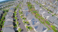 An aerial image over a vast subdivision of housing units in a neighborhood. - stock footage