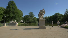 Hermaphroditus and Salmacis and other statues near Lazienki Palace, Warsaw Stock Footage