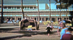 1962: Classic beach hotel with vintage sunning cabana on the sand. Stock Footage