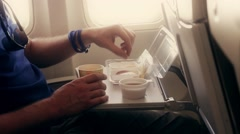 The person eats a breakfast in the old plane economy class Stock Footage
