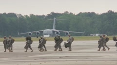 BASE CHARLSTON, MAY 2015, US Air Force Soldiers Walk Over Airfield Stock Footage