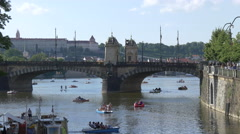 Small pedal boats near Legion Bridge in Prague Stock Footage