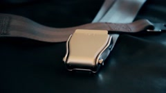 Seat belts lie on seats in the old plane close up Stock Footage