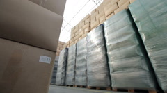 Warehouse With Boxes. Rides Loader Stock Footage