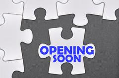 jigsaw puzzle written word opening soon - stock photo