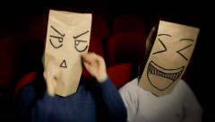 Breadbags faces movie theater anxious amused 2 - stock footage