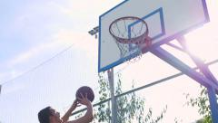 Young, athletic guy trains on sports site. - stock footage