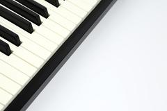 Piano keys closeup on white background Stock Photos