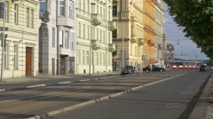 Driving along a row of buildings in Prague Stock Footage