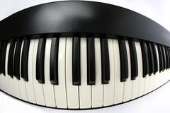 piano keys closeup on white background - stock photo