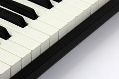 Stock Photo of piano keys closeup on white background