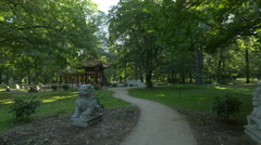The beautiful Chinese garden in Lazienki Park in Warsaw Stock Footage