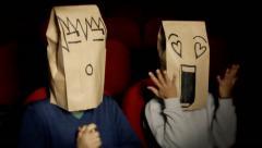Breadbags faces movie theater deploring sentimental 2 Stock Footage