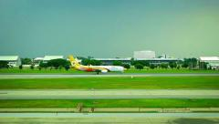 Commercial passanger airplane moves along landing field in Don Mueang Airport Stock Footage