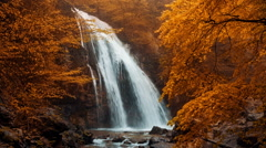 Jur-Jur waterfall in the autumn forest Stock Footage