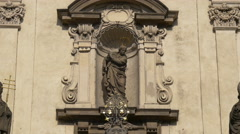 Beautiful statue on St Salvator Church's facade in Prague Stock Footage