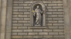 Statue with cross on St Francis of Assisi Church in Prague Stock Footage